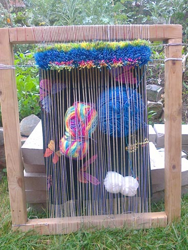 Knotted rug on frame loom with resilience garden behind