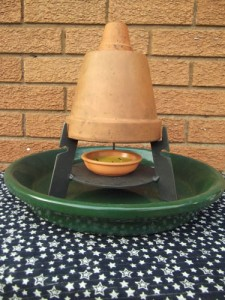 Candle powered stove, full unit with stand and base